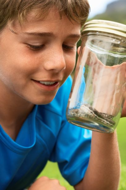 11 year old boy with snake in jar