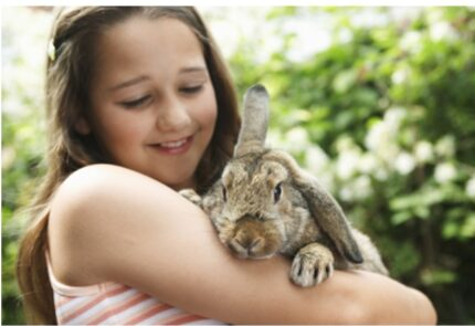 11 year old girl holding a bunny
