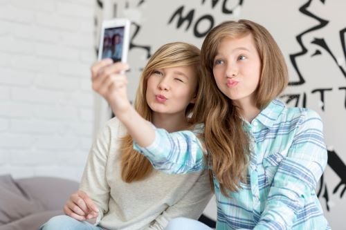 two 13 year old girls are making selfie