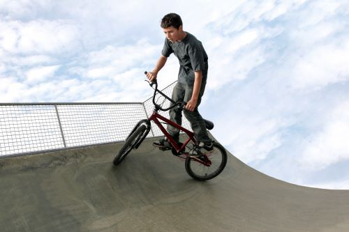 15 year old boy cycling in a skateboard park