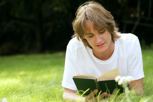17 year old boy reading book