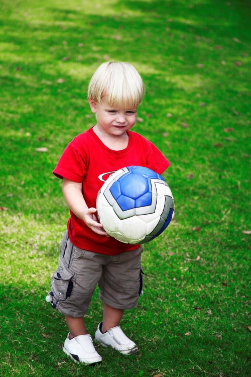 3 year old boy with ball