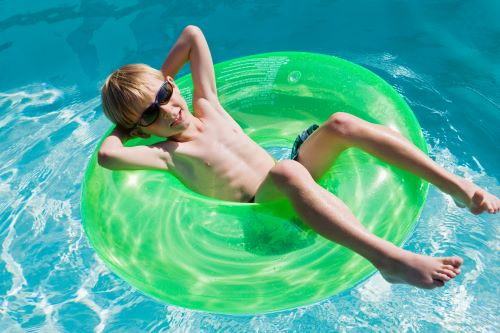 6 year old boy in swimming pool