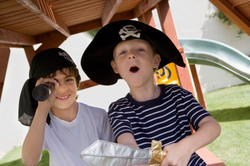 7 year old boy is playing pirate
