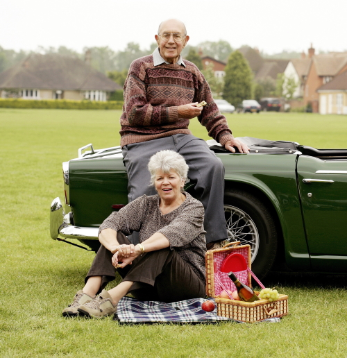 70 year old man and his wife and car