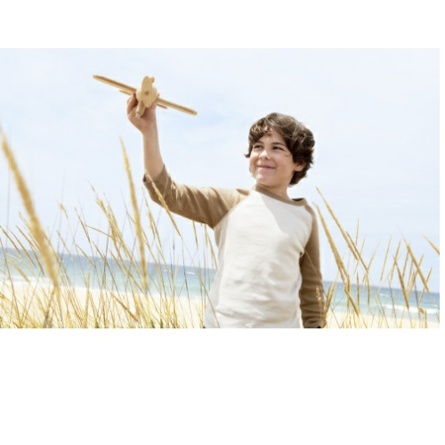 8 year old boy holding a toy airplane