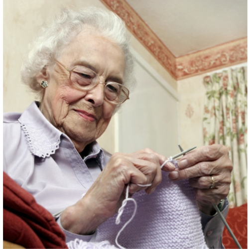 80 year old woman knitting