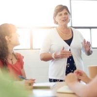 female boss talking in a meeting