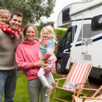 family standing outside of the RV