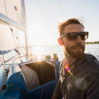 man on a sailboat out at sea