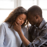 Loving African American husband touching wife face
