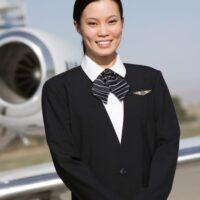 flight attendant in front of plane