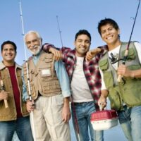 four fishermen with their rods on a dock