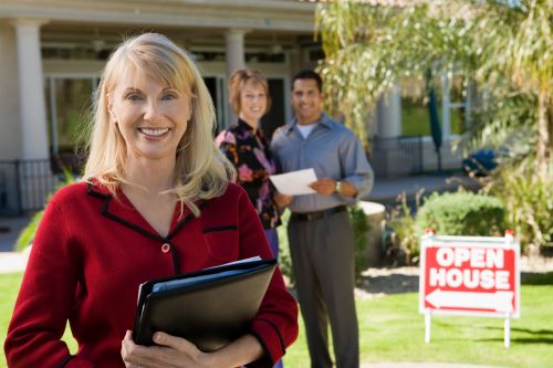 Realtor in front of house