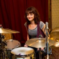 Girl at drum set