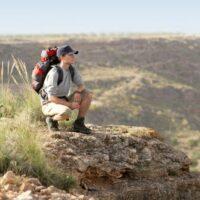 hiker looking over cliff