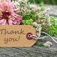 flowers with a thank you card
