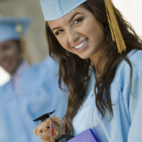 girl at graduation with gift