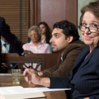 lawyer with client in a courtroom