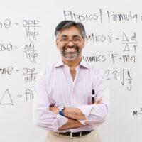 professor in front of white board