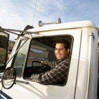 semi-truck driver in his cab