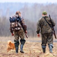 two hunters with their dog