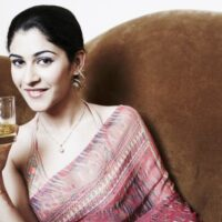 woman holding glass of whiskey