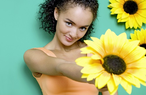 24 year old woman holding a flower